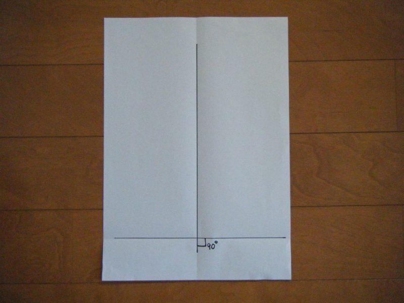 紙に2本の垂直に交わる線を記入したイメージ